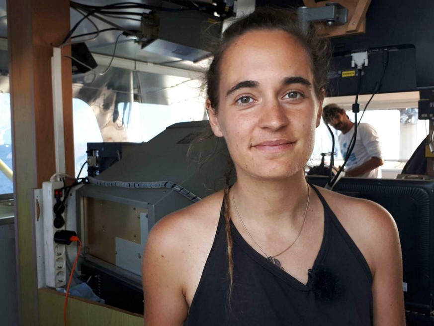 Sea-Watch 3 captain Carola Rackete is seen on board the vessel at sea in the Mediterranean, just off the coasts of the southern Italian island of Lampedusa, Thursday, June 27, 2019. The captain of the humanitarian rescue ship says that Italian law enforcement officials have told them that a resolution is near for 42 migrants rescued at sea that Italy's populist government has so far refused to allow to disembark. (ANSA/Matteo Guidelli via AP)