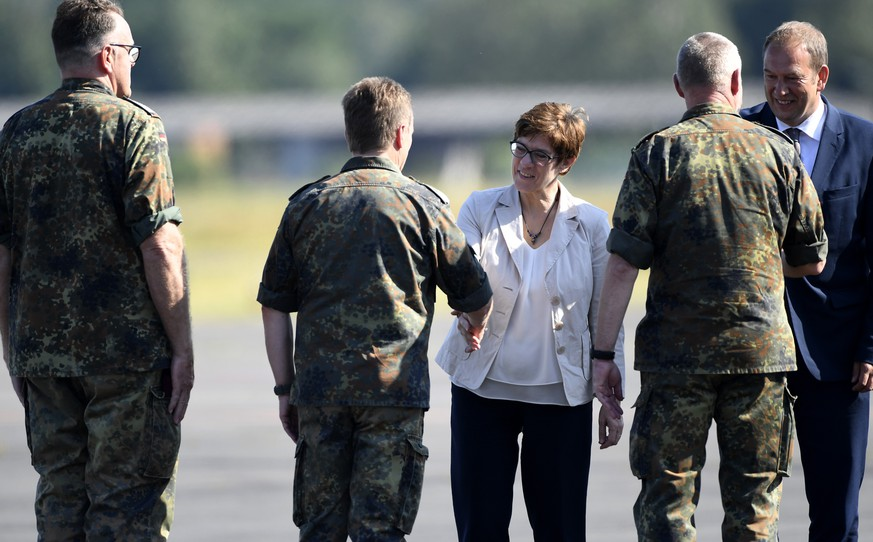 German Defence Minister Annegret Kramp-Karrenbauer welcomes soldiers as she visits troops of the German army Bundeswehr in Celle, Germany July 24, 2019. REUTERS/Fabian Bimmer