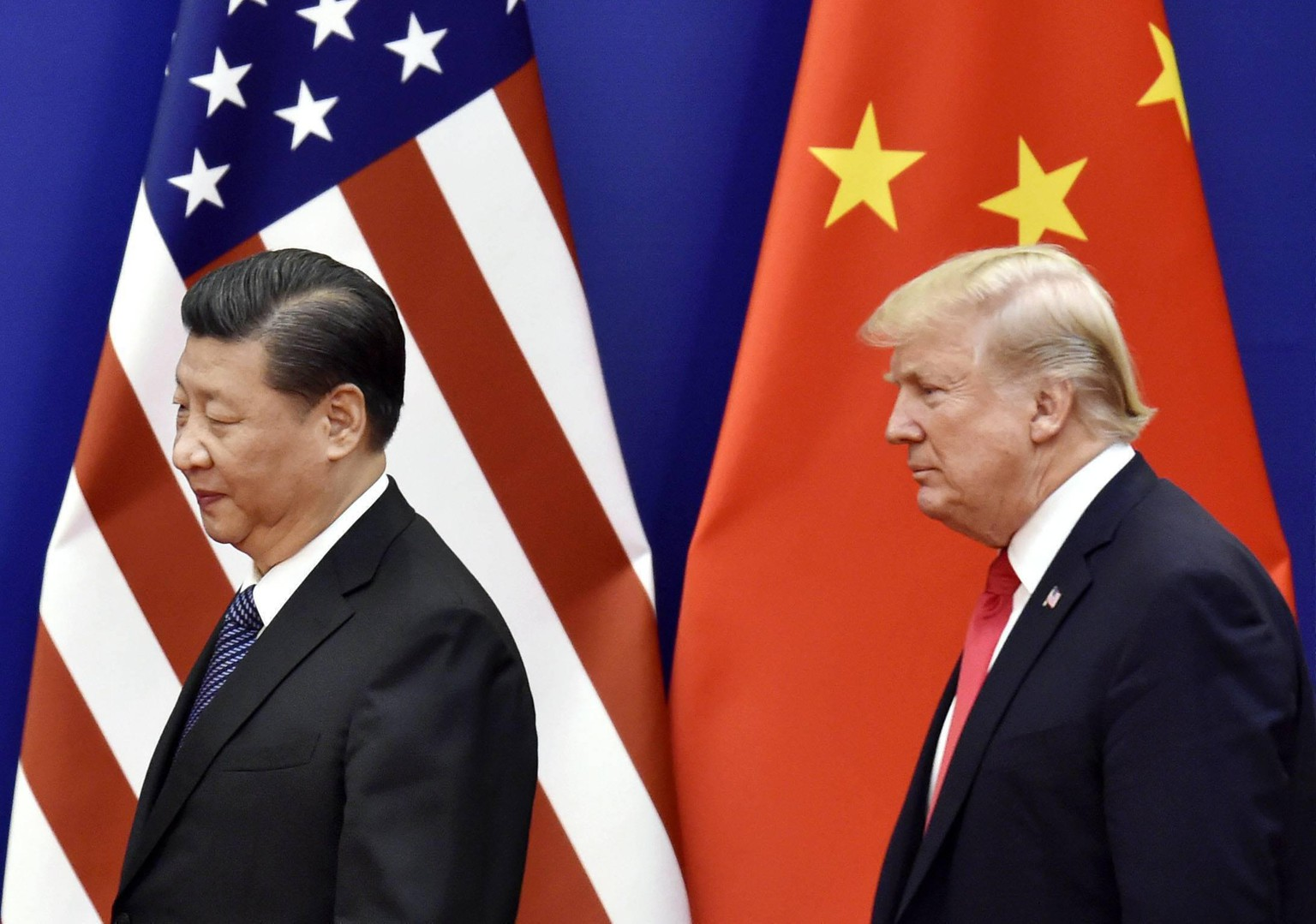 Trump and Xi File photo taken in November 2017 shows U.S. President Donald Trump R and Chinese President Xi Jinping at the Great Hall of the People in Beijing. PUBLICATIONxINxGERxSUIxAUTxHUNxONLY