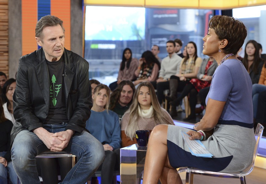 This image released by ABC shows Irish actor Liam Neeson, left, with co-host Robin Roberts on