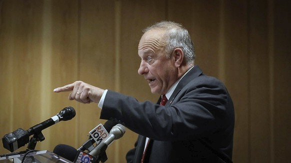 Iowa Congressman Steve King fires back at a man who asked a question about remarks King has made in the past during a candidate forum at the Greater Des Moines Partnership office in Des Moines, Iowa,  Thursday, Nov. 1, 2018. Republican congressman Steve King is rejecting accusations that he's associated with an Austrian white supremacist group. Those claims have prompted condemnation from within his own party just days before Tuesday's election. (Bryon Houlgrave/The Des Moines Register via AP)