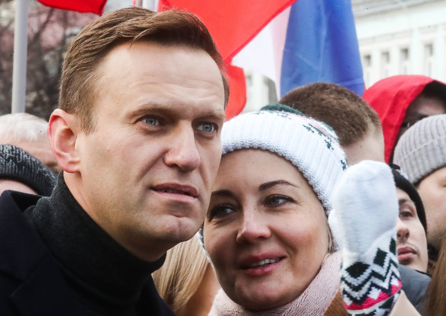 MOSCOW, RUSSIA - FEBRUARY 29, 2020: Opposition activist Alexei Navalny with wife Yulia take part in a memorial march marking the 5th anniversary of the assassination of opposition activist Boris Nemtsov. Boris Nemtsov was shot dead in central Moscow on 27 February 2015. Five men were convicted in 2017 for being hired to murder Nemtsov. Sergei Fadeichev/TASS PUBLICATIONxINxGERxAUTxONLY TS0D030B