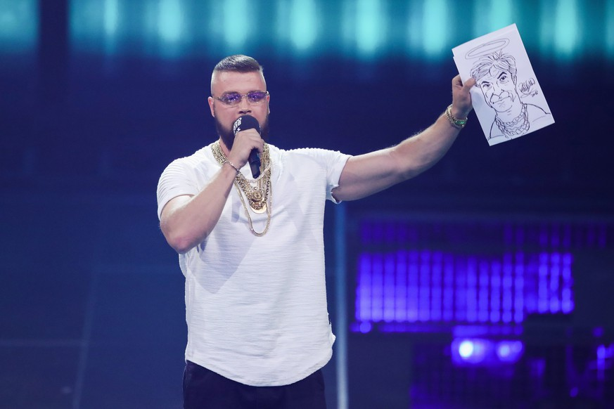 BERLIN, GERMANY - APRIL 12:  'Hip-Hop/Urban - National' award winner Kollegah speaks on stage during the Echo Award show at Messe Berlin on April 12, 2018 in Berlin, Germany.  (Photo by Andreas Rentz/Getty Images)