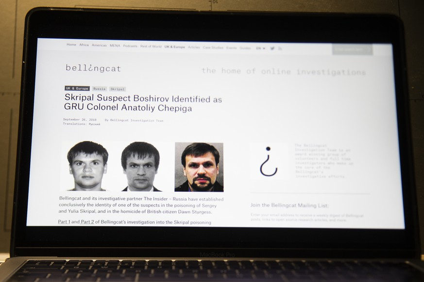 A web site of the British investigative group Bellingcat is seen on a computer screen in Moscow, Russia, Thursday, Sept. 27, 2018. An investigative group in Britain named Bellingcat said one of the two suspects in the March poisoning of Sergei Skripal and his daughter in the U.K. is in fact Col. Anatoliy Chepiga with the Russian military intelligence agency GRU, who in 2014 was awarded Russia's highest medal. (AP Photo/Alexander Zemlianichenko)