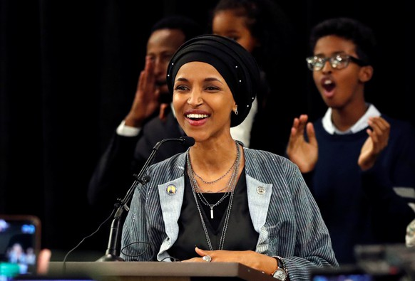 Democratic congressional candidate Ilhan Omar reacts after appearing at her midterm election night party in Minneapolis, Minnesota, U.S. November 6, 2018. REUTERS/Eric Miller