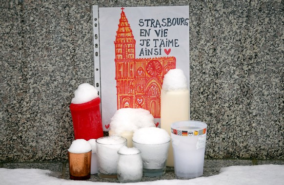 A drawing representing Strasbourg's cathedral is seen at an improvised memorial in tribute to the victims of December 11 attack, during a ceremony in Strasbourg, France, December 16, 2018. The sentence says