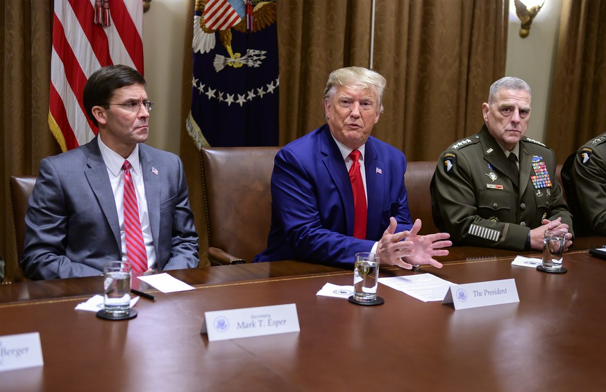 United States President Donald J. Trump answers a reporter s question as he participates in a briefing with senior military leaders in the Cabinet Room of the White House in Washington, DC on Monday, October 7, 2019. At left is United States Secretary of Defense Dr. Mark T. Esper, left, and at right is United States Army General Mark A. Milley, Chairman of the Joint Chiefs of Staff. PUBLICATIONxINxGERxSUIxAUTxHUNxONLY WAX20191007210 RONxSACHS
