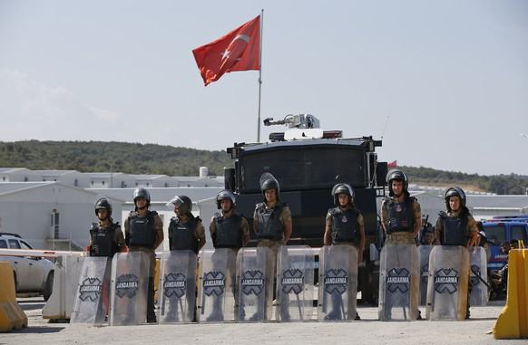 Turkish police officers secure the entrance of Istanbul new airport construction site in Istanbul, Saturday, Sept.15, 2018. A trade union leader says police in Turkey have rounded up hundreds of construction workers at Istanbul's new airport after they staged a protest denouncing poor working conditions. (AP Photo/Emrah Gurel)