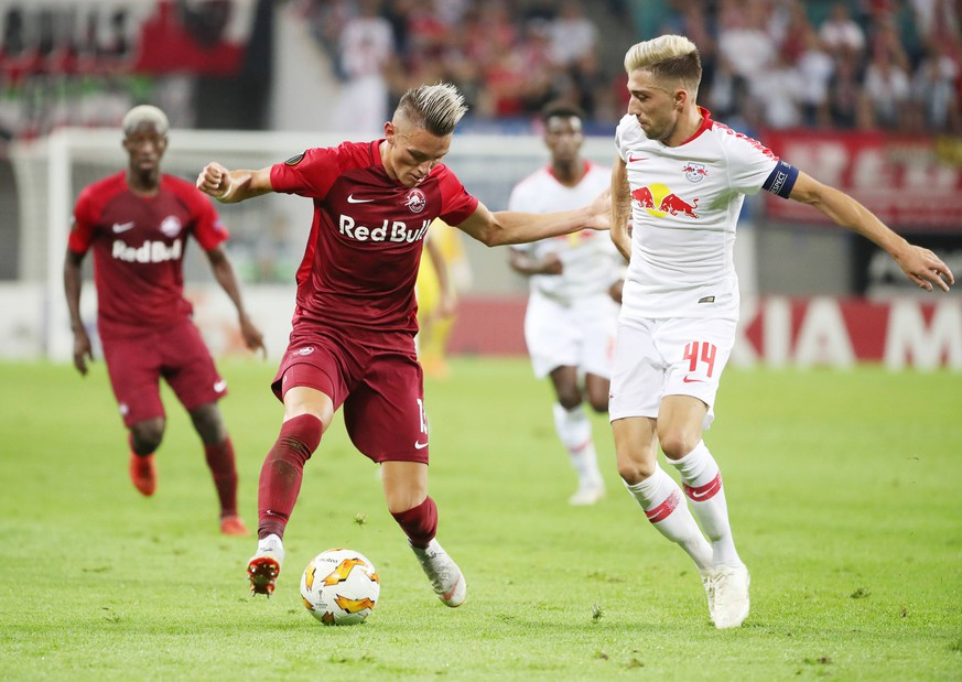SOCCER - EL, RB Leipzig vs RBS LEIPZIG,GERMANY,20.SEP.18 - SOCCER - UEFA Europa League, group stage, RasenBallsport Leipzig vs Red Bull Salzburg. Image shows Hannes Wolf (RBS) and Kevin Kampl (RB Leipzig). PUBLICATIONxINxGERxHUNxONLY GEPAxpictures/xSvenxSonntag
