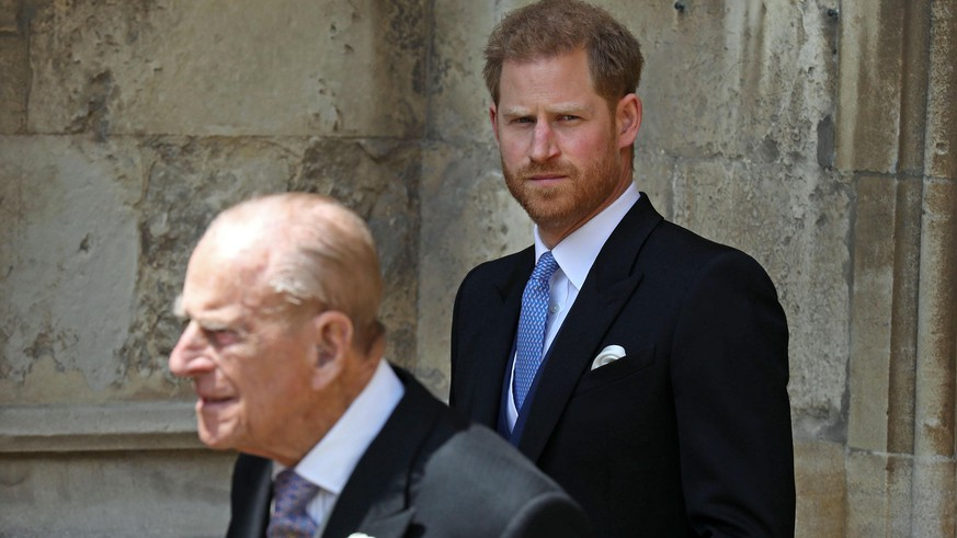 WINDSOR, ENGLAND - MAY 18: Prince Philip, Duke of Edinburgh and Prince Harry, Duke of Sussex leave after the wedding of Lady Gabriella Windsor to Thomas Kingston at St George's Chapel, Windsor Castle on May 18, 2019 in Windsor, England. (Photo by Steve Parsons - WPA Pool/Getty Images)