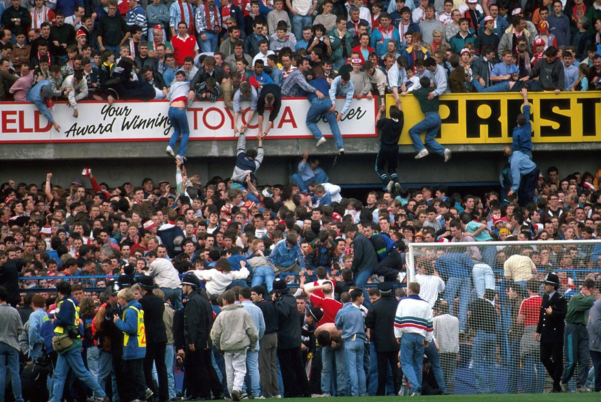 15.04.1989. Sheffield, England. Fans are lifted out of the crush, but 96 are crushed to death in The Hillsborough Disaster. Liverpool v Notts Forest, FA Cup Semi-Final, xACTIONxPLUSxsportsximagesx PUBLICATIONxINxGERxSUIxAUTxHUNxSWExNORxDENxFINxONLY ActionPlus8901