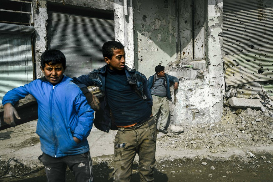 Illustration picture shows boys in the destroyed old city of Mosul during a visit to the WHO Mosul Hospital on the second day of a humanitarian mission of Minister De Croo to Iraq, Tuesday 19 February 2019, in Mosul, Iraq. PUBLICATIONxINxGERxSUIxAUTxONLY DIRKxWAEM 05533813