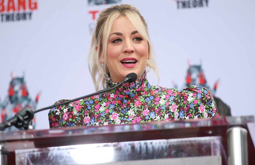 Actor Kaley Cuoco participates in the cement handprints ceremony for the cast of the television comedy