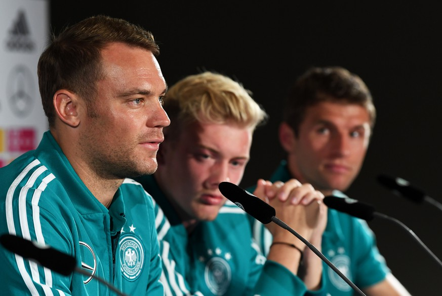 Soccer Football - UEFA Nations League - Germany Press Conference - Hilton Munich Park, Munich, Germany - September 4, 2018   Germany's Manuel Neuer, Julian Brandt and Thomas Mueller during a press conference   REUTERS/Andreas Gebert
