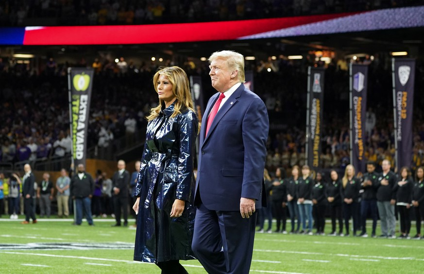 U.S. President Donald Trump and first lady Melania Trump attend the College Football Playoff National Championship game in New Orleans, Louisiana, U.S., January 13, 2020. REUTERS/Kevin Lamarque