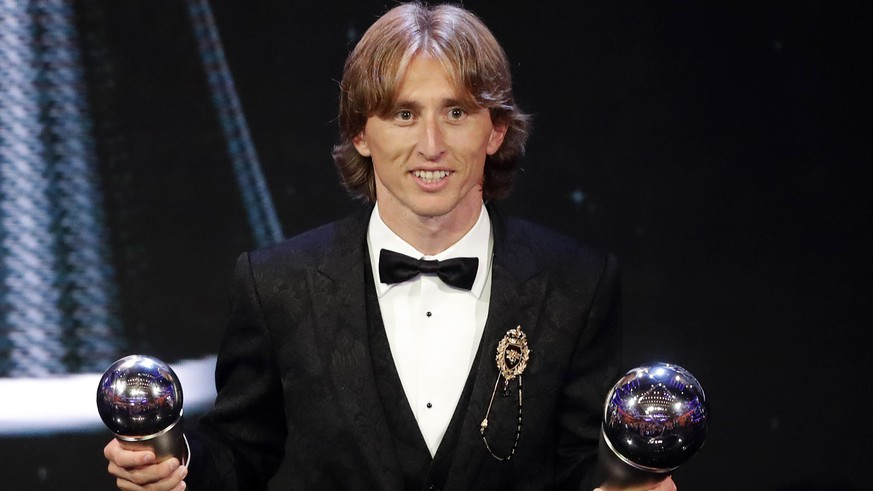 Croatia's Luka Modric receives the Best FIFA Men's Player award during the ceremony of the Best FIFA Football Awards in the Royal Festival Hall in London, Britain, Monday, Sept. 24, 2018. (AP Photo/Frank Augstein)