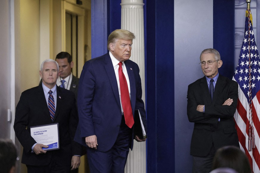 "File photo dated March 26, 2020 of United States President Donald J. Trump, followed by US Vice President Mike Pence arrives as Director of the National Institute of Allergy and Infectious Diseases at the National Institutes of Health Dr. Anthony Fauci, right, looks on at a press briefing in Washington, DC, USA. As the number of confirmed coronavirus cases in the US reached 3m, and another daily record fell with more than 60,000 new cases, Donald Trump insisted the US was ""in a good place"" and admitted he ""didn't listen to my experts"" on July 8. US reaches 3m confirmed Covid-19 cases as Pence pushes for schools to reopen – as it happened; The president also publicly attacked the US's most senior non-political member of the White House coronavirus taskforce, Dr Anthony Fauci, who said earlier this week the US was still ""knee deep in the first wave"" of the pandemic. Photo by Yuri Gripas/ABACAPRESS.COM 