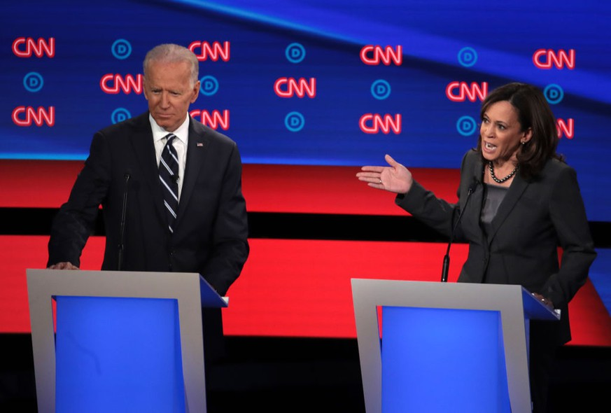 DETROIT, MICHIGAN - JULY 31:  Democratic presidential candidate Sen. Kamala Harris (D-CA) (R) speaks while former Vice President Joe Biden listens during the Democratic Presidential Debate at the Fox Theatre July 31, 2019 in Detroit, Michigan.  20 Democratic presidential candidates were split into two groups of 10 to take part in the debate sponsored by CNN held over two nights at Detroit's Fox Theatre.  (Photo by Scott Olson/Getty Images)