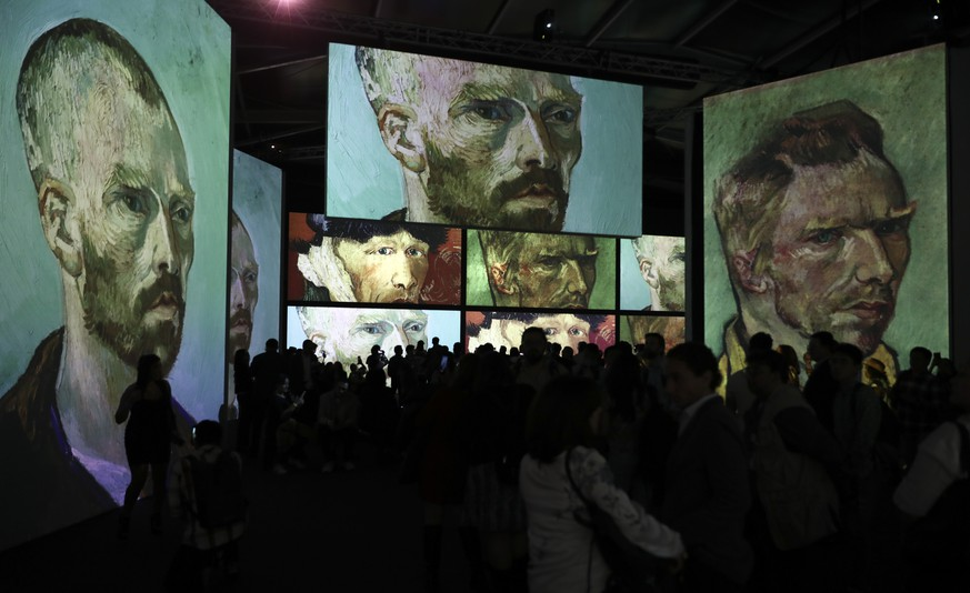 Image of painter Vincent van Gogh are projected during a media tour ahead of the opening of the show titled