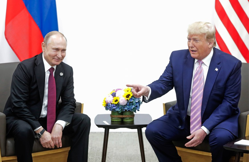 OSAKA, JAPAN - JUNE 28, 2019: Russia s President Vladimir Putin (L) and US President Donald Trump during a meeting on the sidelines of the 2019 G20 Summit at the INTEX Osaka International Exhibition Centre. Mikhail Metzel/TASS PUBLICATIONxINxGERxAUTxONLY TS0B146F
