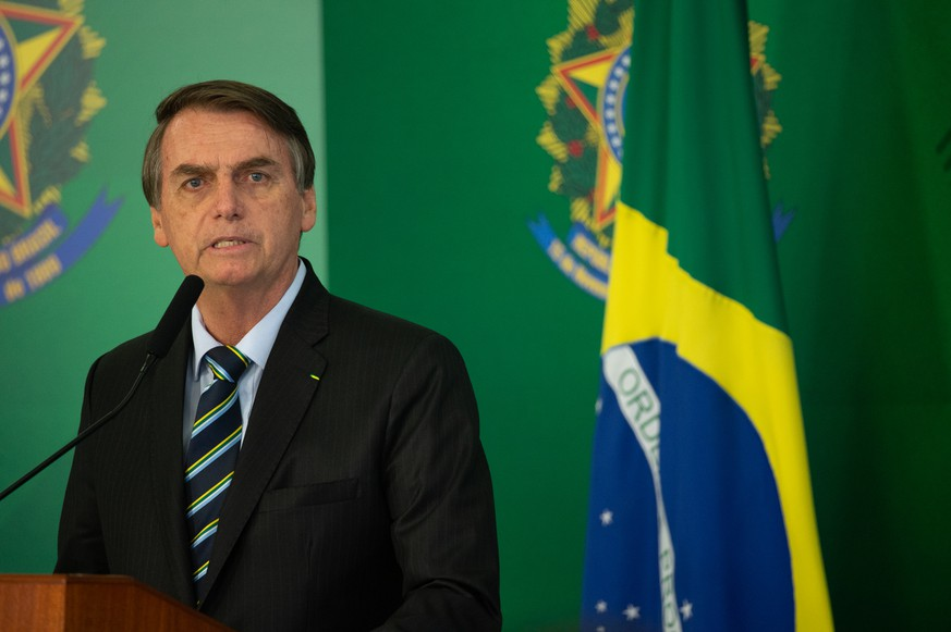 BRASILIA, BRAZIL - FEBRUARY 28: Brazilian President Jair Bolsonaro speaks with press after meeting with venezuelan opposition leader and self-declared iterim president Juan Guaido at Palace Itamaraty on February 28, 2019 in Brasília, Brazil. (Photo by Andressa Anholete/Getty Images)