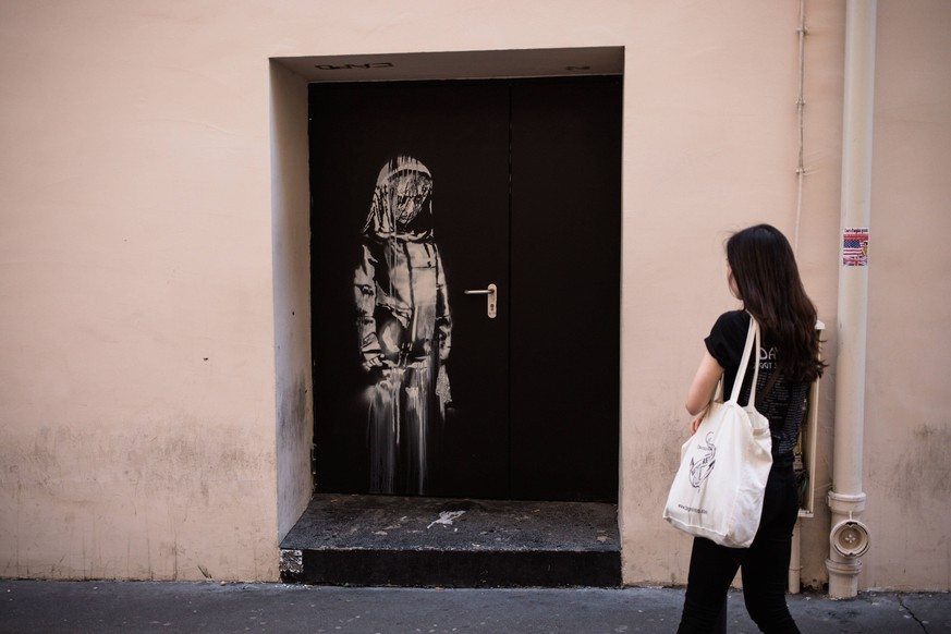 A recent artwork by street artist Banksy in Paris on June 26th, 2018, on a side street to the Bataclan concert hall where a terrorist attack killed 90 people on Novembre 13, 2015. The mysterious British street artist has created a series of new murals in Paris in the last few days. PUBLICATIONxINxGERxSUIxAUTxONLY Copyright: xAurelienxMorissardx