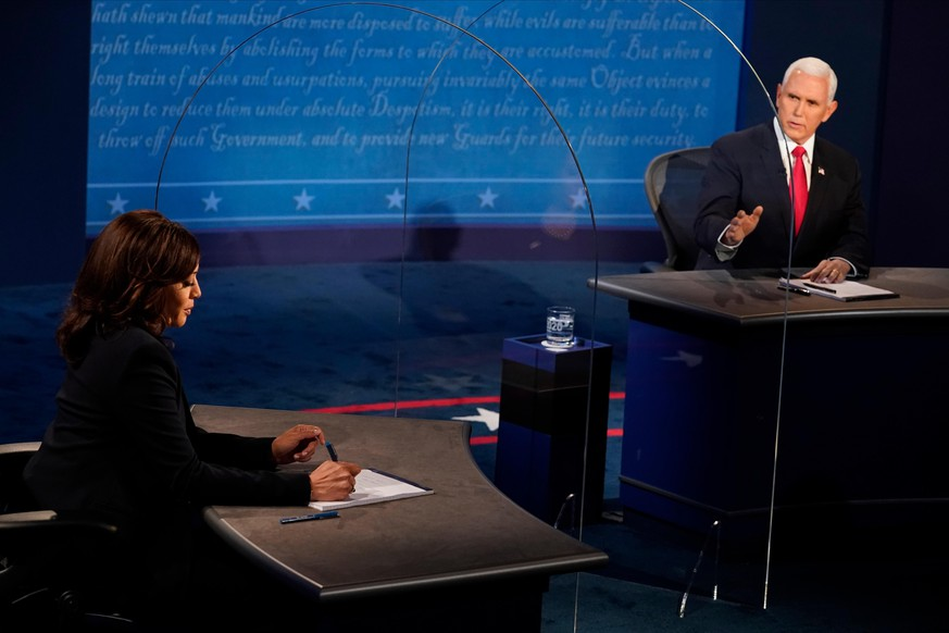 SALT LAKE CITY, UTAH - OCTOBER 07: Democratic vice presidential nominee Sen. Kamala Harris (D-CA) and U.S. Vice President Mike Pence participate in the vice presidential debate at the University of Utah on October 7, 2020 in Salt Lake City, Utah. This is the only scheduled debate between the two before the general election on November 3. (Photo by Morry Gash-Pool/Getty Images)