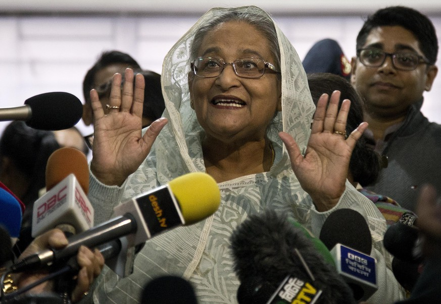 Bangladesh Prime Minister Sheikh Hasina speaks to the media persons after casting her vote in Dhaka, Bangladesh, Sunday, Dec. 30, 2018. Voting began Sunday in Bangladesh's contentious parliamentary elections, seen as a referendum on what critics call Prime Minister Sheikh Hasina's increasingly authoritarian rule. (AP Photo/Anupam Nath)