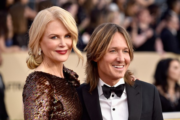 LOS ANGELES, CA - JANUARY 21:  Actor Nicole Kidman (L) and musician Keith Urban attend the 24th Annual Screen Actors Guild Awards at The Shrine Auditorium on January 21, 2018 in Los Angeles, California.  (Photo by Frazer Harrison/Getty Images)