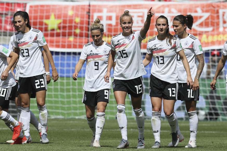 Germany's Giulia Gwinn, center, celebrates after scoring her side's first goal during the Women's World Cup Group B soccer match between Germany and China, at the Roazhon Park stadium, in Rennes, France, Saturday, June 8, 2019. (AP Photo/David Vincent)