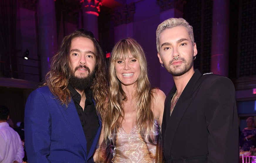 NEW YORK, NEW YORK - OCTOBER 28: (L-R) Tom Kaulitz, Heidi Klum and Bill Kaulitz attend the Angel Ball 2019 hosted by Gabrielle's Angel Foundation at Cipriani Wall Street on October 28, 2019 in New York City. (Photo by Dimitrios Kambouris/Getty Images for Gabrielle's Angel Foundation)