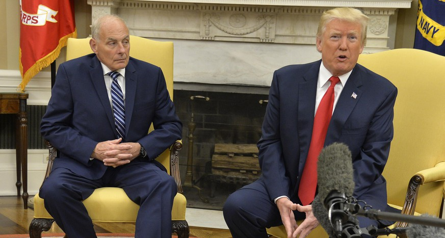 WASHINGTON, D.C. - JULY 31: (AFP-OUT) President Donald Trump (R) speaks to the press after the new White House Chief of Staff John Kelly (L) was sworn in, in the Oval Office of the White House, July 31, 2017 in Washington, DC. Kelly, a retired Marine Corps general and formerly secretary of the Department of Homeland Security, replaces Reince Priebus. (Photo by Mike Theiler-Pool/Getty Images)