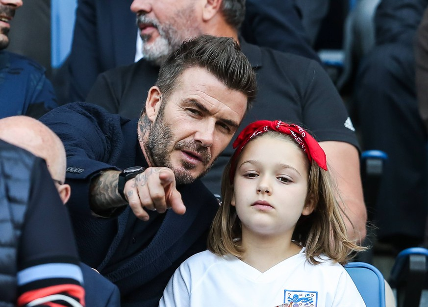 (190628) -- LE HAVRE (FRANCE), June 28, 2019 -- England s football legend David Beckham and his daughter Harper Beckham attend the quarterfinal between England and Norway at the 2019 FIFA Women s World Cup in Le Havre, France, on June 27, 2019. England won 3-0. ) (SP)FRANCE-LE HAVRE-FIFA WOMEN S WORLD CUP-QUARTERFINAL-ENG VS NOR ShanxYuqi PUBLICATIONxNOTxINxCHN