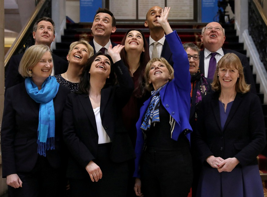 REFILE - CORRECTING HEADLINE  Sarah Wollaston, Heidi Allen, Anna Soubry, Joan Ryan, Angela Smith, Luciana Berger, Ann Coffey, Chris Leslie, Gavin Shuker, Chuka Umunna and Mike Gapes pose for picture at a news conference in London, Britain February 20, 2019. REUTERS/Simon Dawson