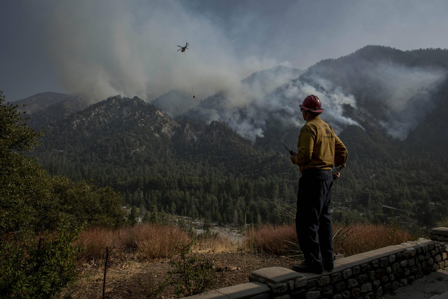 September 14, 2020, Forest Falls, California, USA: Captain JAMES KLOSEK of the Santa Barbara County Fire Department observes Helicopter operations at the El Dorado Fire. The is at 39% containment as of Monday afternoon. Forest Falls USA - ZUMAm162 20200914_zap_m162_002 Copyright: xErickxMadridx