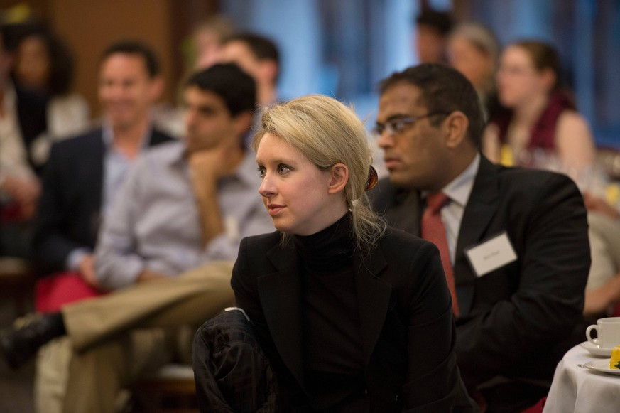 April 17, 2013 - Palo Alto, United States - Healthcare technology company Theranos Founder and CEO Elizabeth Holmes listens to U.S. Deputy Secretary of Defense Ashton Carter speak at Stanford University April 17, 2013 in Palo Alto, California. Palo Alto United States PUBLICATIONxINxGERxSUIxAUTxONLY - ZUMAp138 20130417_zaa_p138_020 Copyright: xGlennxFawcettx