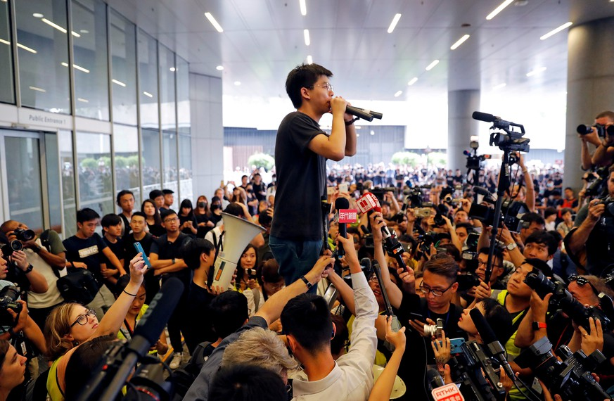 FILE PHOTO: Pro-democracy activist Joshua Wong addresses the crowds outside the Legislative Council during a demonstration demanding Hong Kong's leaders step down and withdraw the extradition bill, in Hong Kong, China June 17, 2019. REUTERS/Jorge Silva/File Photo To match Special Report HONGKONG-PROTESTS/PROTESTERS