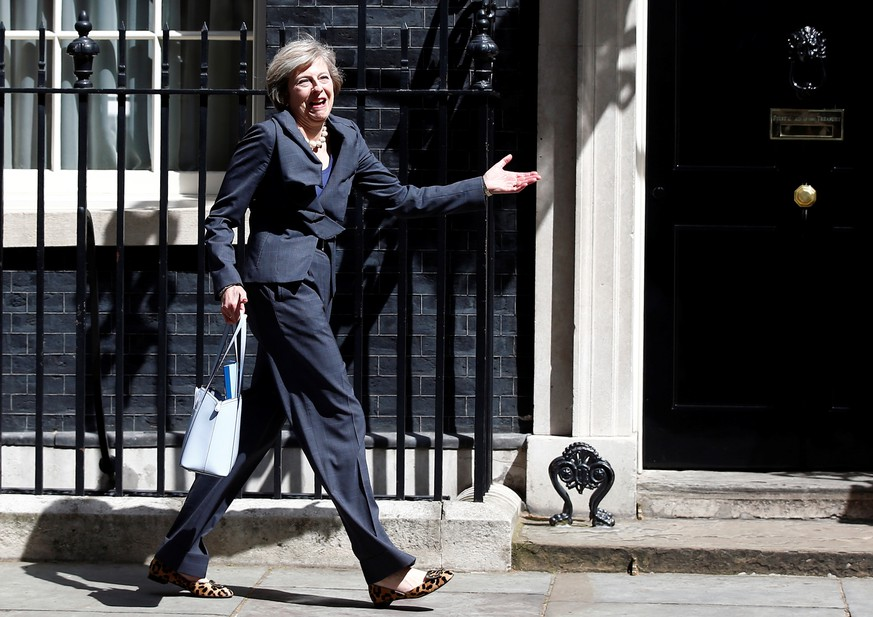 FILE PHOTO: Britain's Home Secretary Theresa May leaves after a cabinet meeting at number 10 Downing Street in London, Britain, July 12, 2016. REUTERS/Peter Nicholls/File Photo