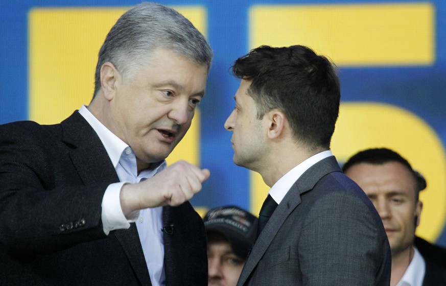 April 19, 2019 - Kiev, Ukraine - Ukrainian President and Presidential candidate PETRO POROSHENKO (L) and Ukrainian comedian actor and presidential candidate VOLODYMYR ZELENSKIY (R) speak during debate at the Olimpiyskiy Stadium in Kiev, Ukraine, 19 April 2019. The second round of presidential elections will held on April 21. Kiev Ukraine PUBLICATIONxINxGERxSUIxAUTxONLY - ZUMAg194 20190419_zap_g194_007 Copyright: xSergxGlovnyx