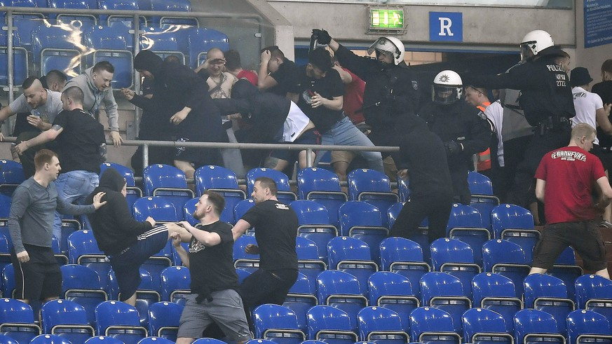 Supporters from Schalke and Frankfurt fight on the tribune after the German soccer cup semifinal match between FC Schalke 04 and Eintracht Frankfurt in Gelsenkirchen, Germany, Wednesday, April 18, 2018. Schalke was defeated by Frankfurt with 0-1. (AP Photo/Martin Meissner)