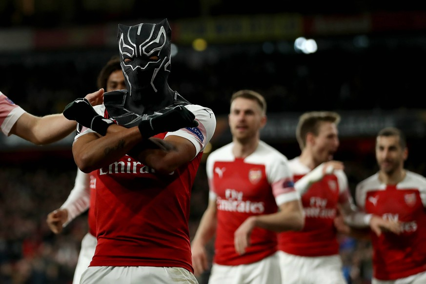 14th March 2019, Emirates Stadium, London, England; UEFA Europa League football, round of 16, second leg, Arsenal versus Rennes; Pierre-Emerick Aubameyang of Arsenal celebrates in a spiderman mask as he scores for 3-0 in the 72nd minute PUBLICATIONxINxGERxSUIxAUTxHUNxSWExNORxDENxFINxONLY ActionPlus12114682 ShaunxBrooks