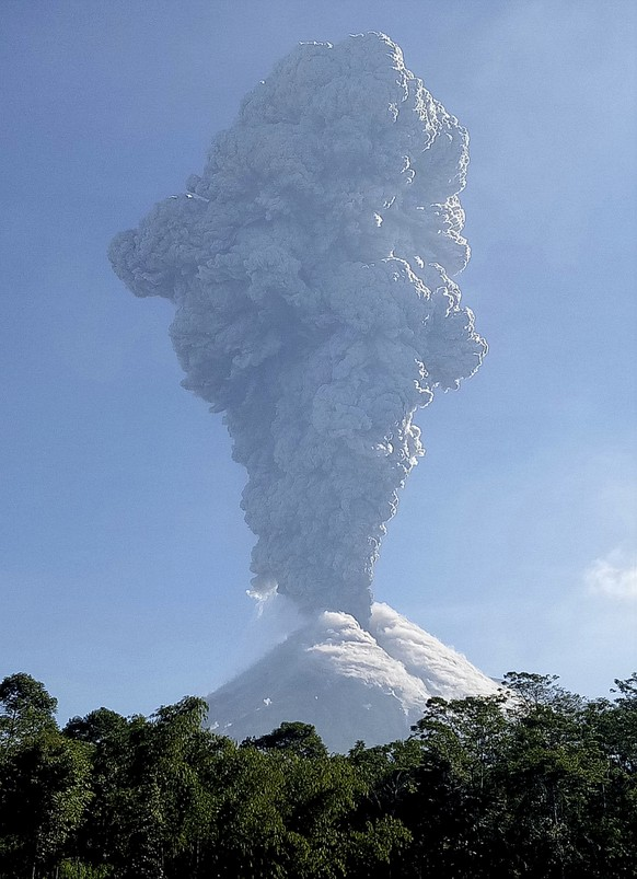 Mount Merapi shoots volcanic ash as seen from Cangkringan, Yogyakarta, Indonesia, Friday, June 1, 2018. The country's most volatile volcano shot a towering plume of ash about 6 kilometers (4 miles) high Friday in an eruption authorities said lasted two minutes. (AP Photo/Slamet Riyadi)