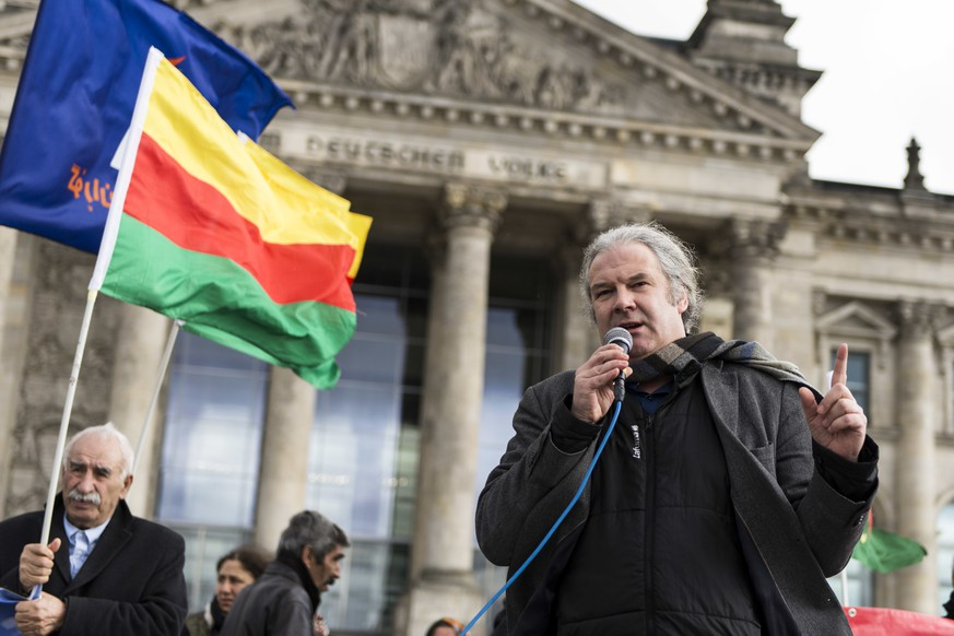 March 10, 2017 - Berlin, Berlin, Germany - ANDREJ HUNKO, Mitglied des Deutschen Bundestags fr die Partei Die Linke, speaks in front of the protesters. Yezidi representatives and Kurds demanding political support in front of the German Reichstag-Building for the people in Sinjar. The situation of the Yezidians, a thousand-year monotheistic religious community, has worsened after Kurdish Peschmergas attacked the Kurdish Yezidian units in Shengal |