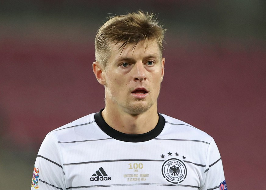 Soccer Football - UEFA Nations League - League A - Group 4 - Germany v Switzerland - RheinEnergieStadion, Cologne, Germany - October 13, 2020. Germany's Toni Kroos wearing a shirt commemorating his 100th match for Germany REUTERS/Wolfgang Rattay
