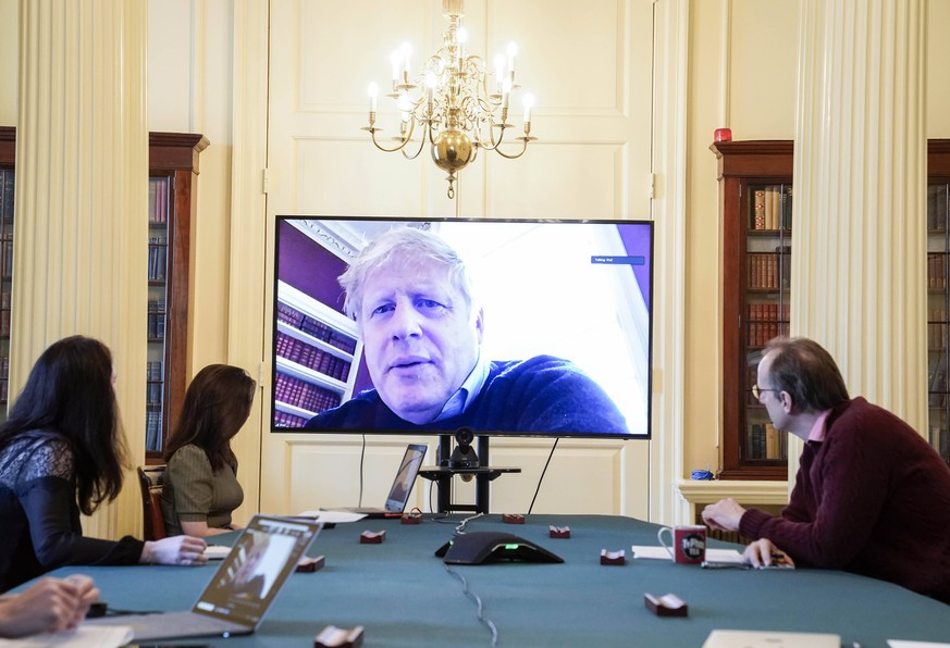 200329 -- LONDON, March 29, 2020 Xinhua -- British Prime Minister Boris Johnson C chairs a morning COVID-19 update meeting remotely during his self-isolation after testing positive for COVID-19, in London, Britain, on March 28, 2020. A total of 19,522 COVID-19 cases have been confirmed in Britain as of Sunday morning, marking an increase of 2,433 in the past 24 hours, according to the Department of Health and Social Care. Andrew Parsons/No 10 Downing Street/Handout via Xinhua EDITORIAL USE ONLY BRITAIN-LONDON-PM-COVID-19-SELF-ISOLATION PUBLICATIONxNOTxINxCHN