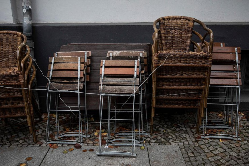 BERLIN, GERMANY - OCTOBER 15: Chairs are stacked together outside a restaurant on October 15, 2020 in Berlin, Germany. Due to the significant increase in coronavirus infections, most stores and all restaurants and bars in Berlin have to close from 11 p.m. to 6 a.m. in the future. On Tuesday (October 6, 2020), the Senate passed a night-time curfew. Clubs, which have been closed for months, are struggling to stay alive. (Photo by Maja Hitij/Getty Images)