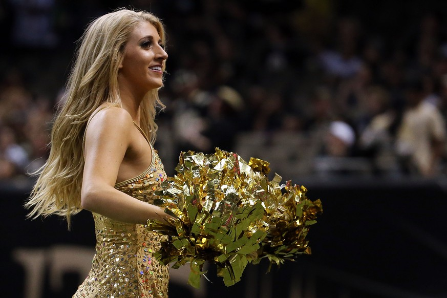 NEW ORLEANS, LA - DECEMBER 27:  Cheerleaders for the New Orleans Saints perform during a game against the Jacksonville Jaguars at the Mercedes-Benz Superdome on December 27, 2015 in New Orleans, Louisiana.  (Photo by Chris Graythen/Getty Images) Davis Bailey