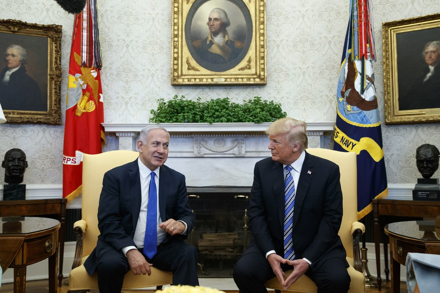 FILE - In this March 5, 2018, file photo, President Donald Trump meets with Israeli Prime Minister Benjamin Netanyahu in the Oval Office of the White House in Washington. After a rocky eight-year relationship with Barack Obama, Netanyahu has relished Trump's warm embrace. In a break from his predecessors, Trump has refrained from criticizing Israeli settlement activity and delivered Netanyahu two major international gifts, recognizing Jerusalem as Israel's capital and pulling out of the Iran nuclear deal. (AP Photo/Evan Vucci, File)