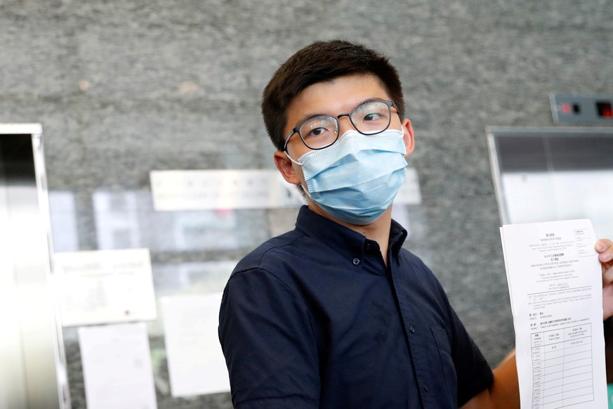 FILE PHOTO: Pro-democracy activist Joshua Wong registers as a candidate for the upcoming  Legislative Council election in Hong Kong, China July 20, 2020. REUTERS/Tyrone Siu/File Photo