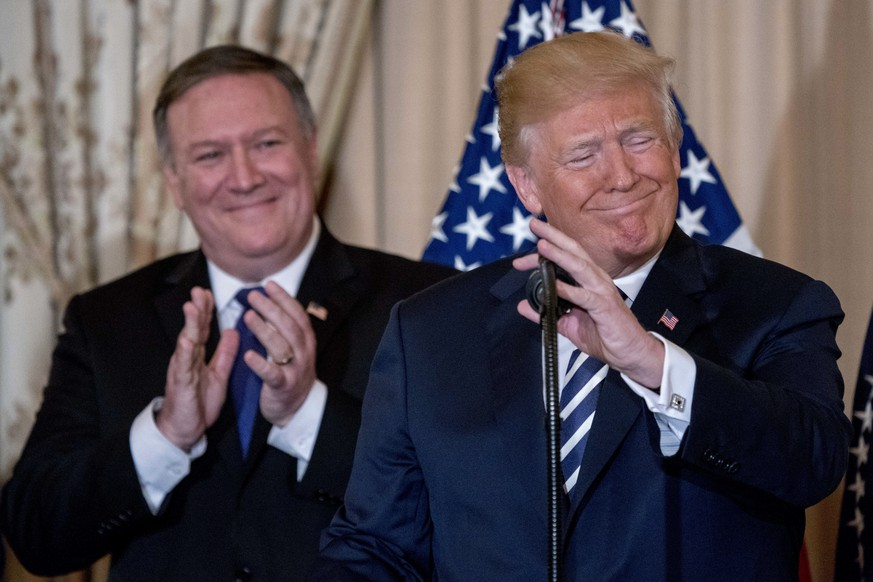 President Donald Trump, accompanied by Secretary of State Mike Pompeo, speaks during a ceremonial swearing in for Pompeo at the State Department, Wednesday, May 2, 2018, in Washington.  (AP Photo/Andrew Harnik)